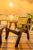 Wood chair sunset on the beach — Stock Photo