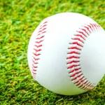 Baseball on green grass — Stock Photo #49835947