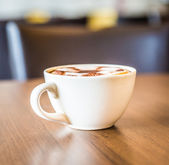 Coffee cup in coffee shop — Photo