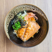 Salmon teriyaki on rice — Stock Photo