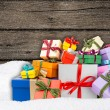 Colorful gift boxes in snow — Stock Photo