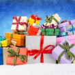 Xmas gift boxes in snow — Stock Photo
