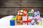 Colorful gift boxes in snow — Foto Stock