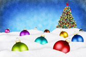 Christmas balls and xmas tree in snow — Stock Photo