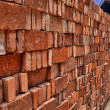 Stock Photo: Pile of red bricks for construction