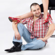 Man under womans' legs — Stock Photo