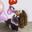 Stock Photo: Girl with heart baloon
