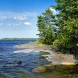 Stony shore of Ladoga lake, Russia - Stock Photo
