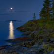 Moonlit night at stony shore of Ladoga lake — Stock Photo