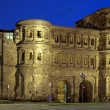 Evening view of the Porta Nigra (Black Gate) in Trier, Germany - Stock Photo