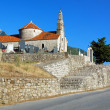 Church and cemetery on a mountain road in Montenegro - Stock Photo