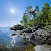 Sun and stony shore of Ladoga lake — Stock Photo