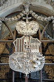 Coat-of-arms made with bones in Sedlec ossuary, Czech Republic — Stock Photo
