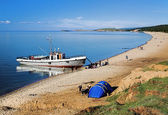 Ship at the shore of Olkhon island on Baikal lake — Stock Photo