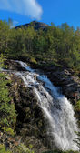 Waterfall on Risjok river and Kuelporr Mount in Khibiny Mountain — Stock Photo