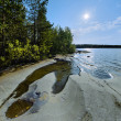 Sun and stony shore of Ladoga lake — Stockfoto