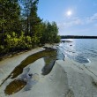 Sun and stony shore of Ladoga lake — 图库照片