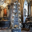 Stock Photo: Floor candlestick with skulls in Sedlec ossuary, Czech Republic