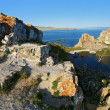 Shamanka-Rock on Olkhon island at Baikal lake - Stock Photo