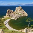 Shamanka-Rock on Baikal lake - Stock Photo