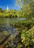 Autumn landscape with church — Stock Photo