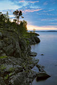 Sunset at stony shore of Ladoga lake — Stock Photo