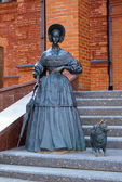 Sculpture of a Lady with a small dog — Stock Photo