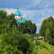 Embankment of river Vyatka and wooden Church, Kirov - Photo