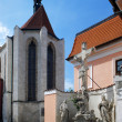 Sculpted crucifix and Church in Ceske Budejovice — Stock Photo