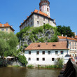 Cesky Krumlov Castle and rafting on Vltava river - Stock Photo