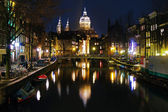 Evening view on the St. Nicolas Church in Amsterdam — Stock Photo