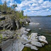 Stony shore of Ladoga lake — Stock Photo