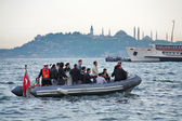 People crossing the Bosphorus in a rubber boat — Stock Photo