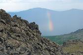 Rainbow on a background of Kazansky Rock Mount, Northern Ural — Stock Photo