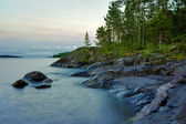 Stony shore of Ladoga lake at white night, Russia — Stock Photo