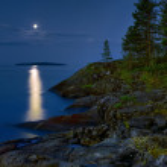 Moonlit night at stony shore of Ladoga lake — Stock Photo #48177695