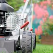 Lawn mower in the garden — Stock Photo #23036448