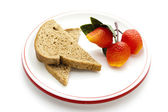 Plastic Fruits with Whole Wheat Toast on Plate — Stock Photo