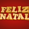 Foto Stock: Golden Feliz Natal (Merry Christmas in portuguese) text on a red background