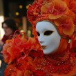 Beautiful red mask. Carnival in Venice. - Stock Photo