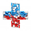 Health cross - made up of pills and capsules — Stock Photo #18366615