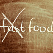 Fast food written on a blackboard with white chalk. — Stock Photo