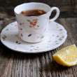 Stock Photo: Cup of tewith lemon