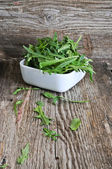 Bowl of fresh green, natural arugula — Stock Photo