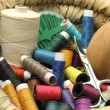 Colored threads and sewing accessories — Stock Photo