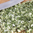 Chopped herbs and mezzaluna - Stock Photo