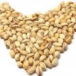 Heart made of pistachio nuts — Stock Photo #19325801