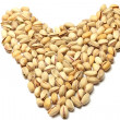 Heart made of pistachio nuts — Stock Photo #19325831