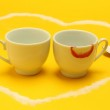 Two cups of coffee inside a heart, one of them with lipstick — Stock Photo #31936871