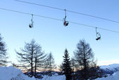 Chairlift at sunset — Stock Photo